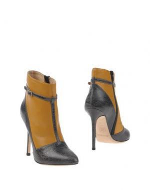 Полусапоги и высокие ботинки ERNESTO ESPOSITO. Цвет: охра