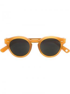 Солнцезащитные очки в круглой оправе Ahlem. Цвет: телесный