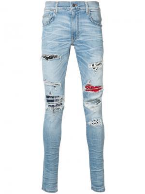 Distressed skinny jeans Amiri. Цвет: синий