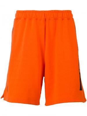 Спортивные шорты Omc. Цвет: жёлтый и оранжевый
