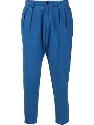 Зауженные к низу брюки Blue Japan. Цвет: синий