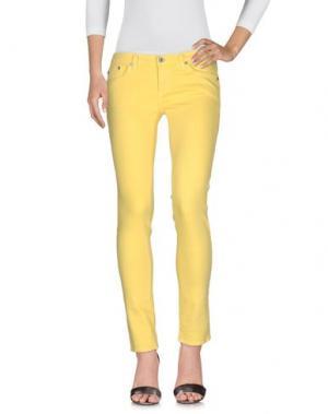 Джинсовые брюки AG ADRIANO GOLDSCHMIED. Цвет: желтый