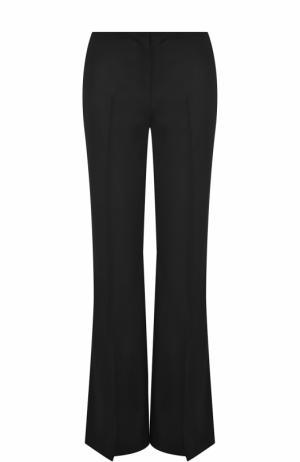 Шерстяные расклешенные брюки со стрелками The Row. Цвет: черный