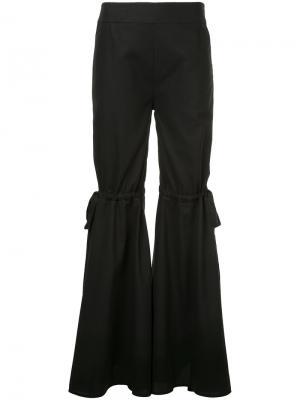Расклешенные брюки с бантами Teija. Цвет: чёрный