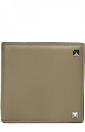 Кожаное портмоне  Garavani с металлическими шипами Valentino. Цвет: хаки