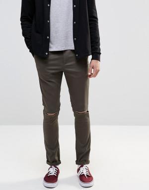 ASOS Хлопковые суперзауженные брюки хаки с рваной отделкой. Цвет: зеленый