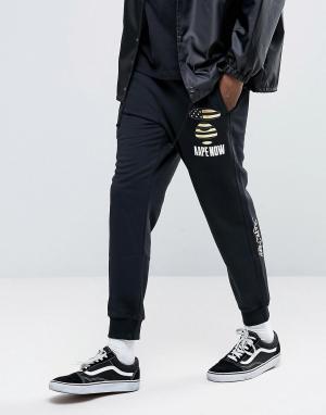 AAPE BY A BATHING APE Спортивные штаны с принтом. Цвет: черный