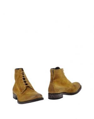 Полусапоги и высокие ботинки MOMA. Цвет: желтый