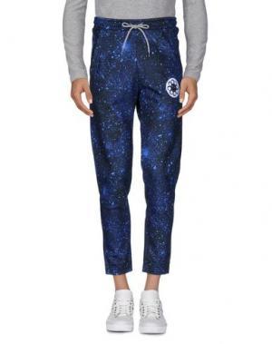 Повседневные брюки OCTOPUS. Цвет: синий