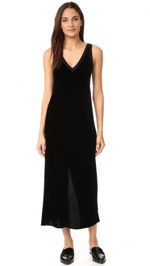 Платье-комбинация с V-образным вырезом и разрезом сзади DKNY. Цвет: голубой