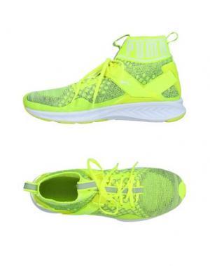 Высокие кеды и кроссовки PUMA. Цвет: желтый