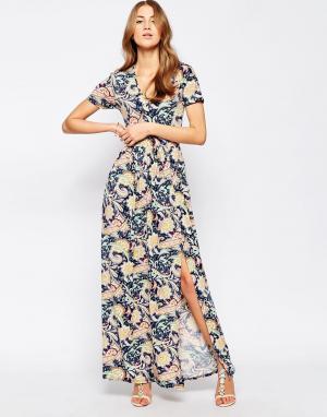 Club L Платье макси с цветочным плиточным принтом и разрезом спереди. Цвет: темно-синий