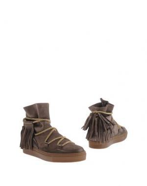 Полусапоги и высокие ботинки SVNTY. Цвет: хаки