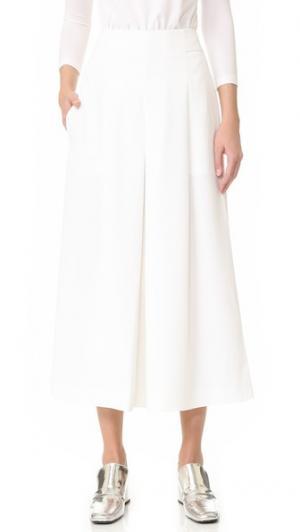 Плиссированная юбка-брюки из твила Tibi. Цвет: белый