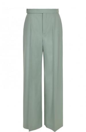 Расклешенные шерстяные брюки со стрелками Chloé. Цвет: светло-зеленый