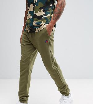 Russell Athletic Суперузкие джоггеры. Цвет: зеленый