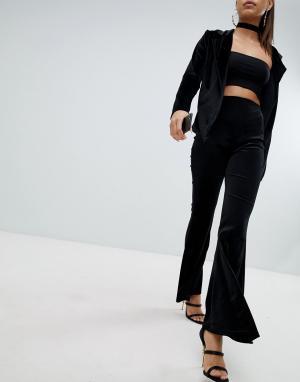 Lasula Бархатные расклешенные брюки. Цвет: черный