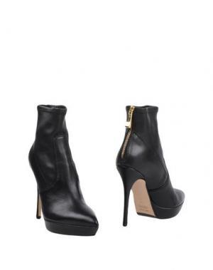 Полусапоги и высокие ботинки THE SELLER. Цвет: черный