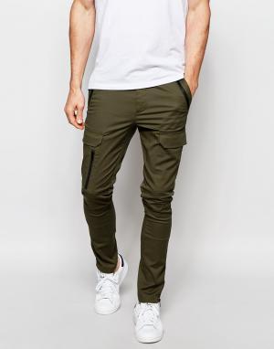 ASOS Супероблегающие брюки цвета хаки с карманами карго на молнии. Цвет: зеленый