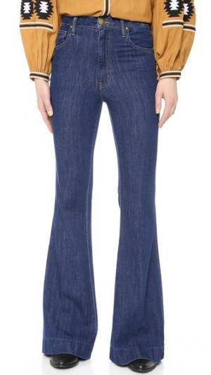 Широкие джинсы с высокой посадкой THE GREAT.. Цвет: потертый темный индиго