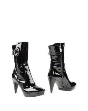 Полусапоги и высокие ботинки CARAVELLE. Цвет: черный