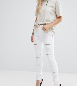 ASOS Petite Белые джинсы скинни с завышенной талией и рваной отделкой. Цвет: белый