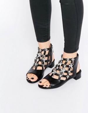 Eeight Черно-серебристые сандалии со звездами Gisele. Цвет: черный