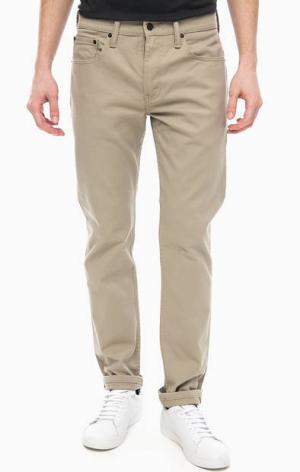 Зауженные бежевые брюки из денима 502™ Regular Taper Levi's®. Цвет: бежевый