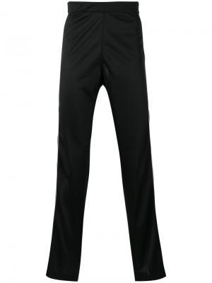 Спортивные брюки с лампасами Maison Margiela. Цвет: чёрный