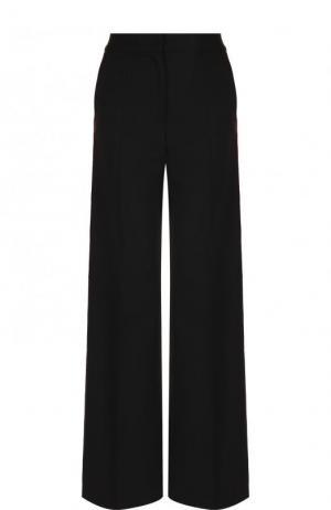 Расклешенные брюки из смеси шерсти и шелка с контрастными лампасами Dolce & Gabbana. Цвет: черный
