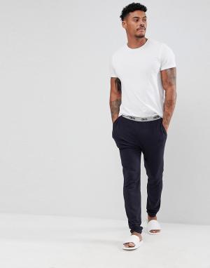 ASOS Трикотажные пижамные брюки узкого кроя с фирменным поясом. Цвет: темно-синий