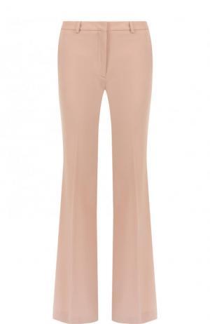 Однотонные расклешенные брюки из шерсти со стрелками Theory. Цвет: розовый