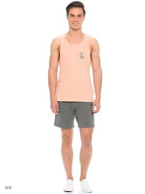 Майка спортивная Calvin Klein. Цвет: персиковый