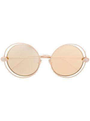 Солнцезащитные очки в круглой оправе Boucheron. Цвет: металлический