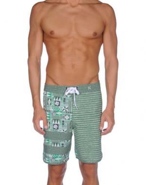 Пляжные брюки и шорты HURLEY. Цвет: зеленый