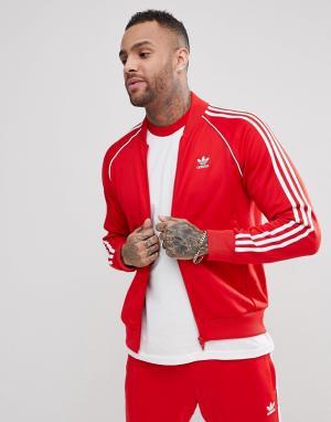 Adidas Originals Красная спортивная куртка adicolor CW1257. Цвет: красный