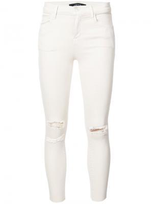 Рваные облегающие джинсы J Brand. Цвет: телесный