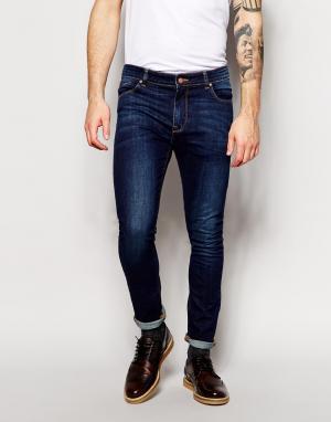 ASOS Выбеленные супероблегающие джинсы темного цвета. Цвет: синий