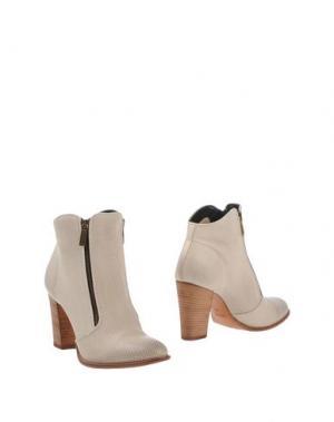 Полусапоги и высокие ботинки FIORIFRANCESI. Цвет: бежевый