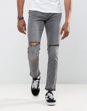 Antioch Зауженные джинсы с рваной отделкой и развернутым краем. Цвет: серый