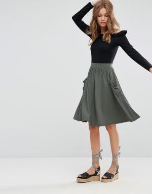 ASOS Трикотажная юбка миди с карманами. Цвет: зеленый