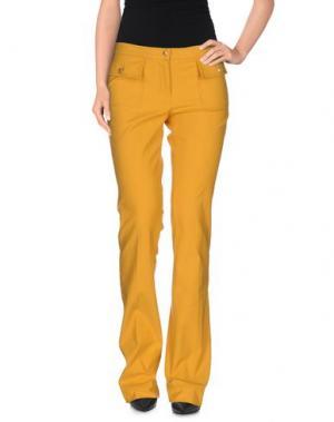 Повседневные брюки ROBERT RODRIGUEZ. Цвет: охра