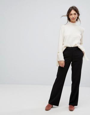 Vila Расклешенные брюки. Цвет: черный