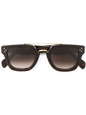 Солнцезащитные очки с узором черепашьего панциря Céline Eyewear. Цвет: коричневый