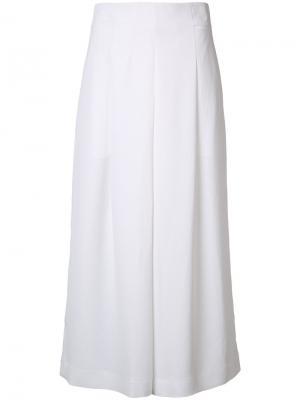 Расклешенные укороченные брюки Tibi. Цвет: белый