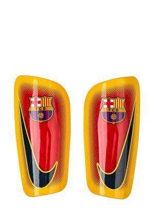 Щитки Nike. Цвет: желтый