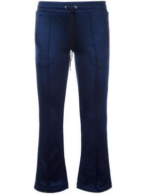 Расклешенные спортивные брюки Mm6 Maison Margiela. Цвет: синий