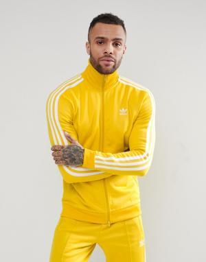 Adidas Originals Желтая спортивная куртка adicolor Beckenbauer CW1254. Цвет: желтый