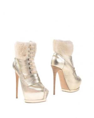 Полусапоги и высокие ботинки GIANMARCO LORENZI. Цвет: платиновый