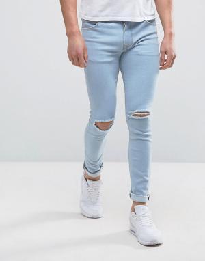 ASOS Голубые супероблегающие джинсы с рваной отделкой. Цвет: синий